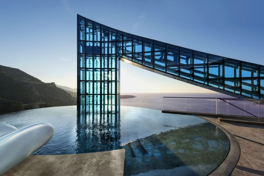 Alexandre Giraldi (above) is the Monegasque architect behind the Tour Odeon where the world's most expensive penthouse includes a water slide that goes from the dance floor directly down into the infinity pool.